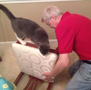 Dad and Elvis fixing a chair